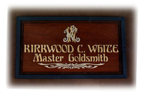 Carved wood sign with gold leaf designed and built by Dennis Knicely, sign and design artist